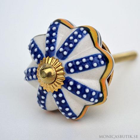 Knopp med blå dekor