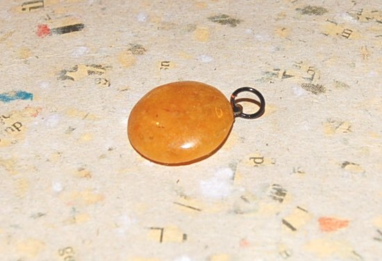 Aragonit sten med ögla