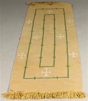 Matta märkt AVS i ull med fransar av bomull. Mått: 243 x 93 cm