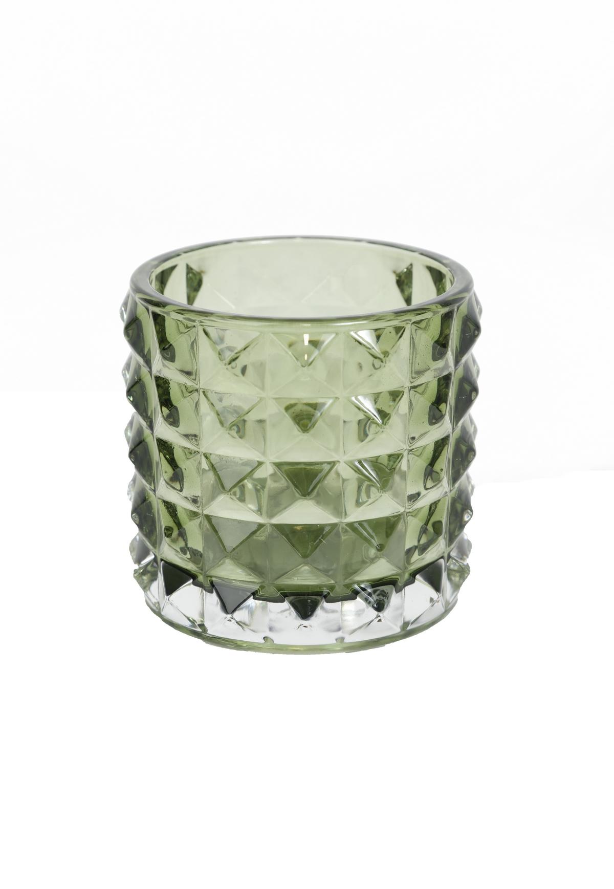 grön ljuslykta i glas
