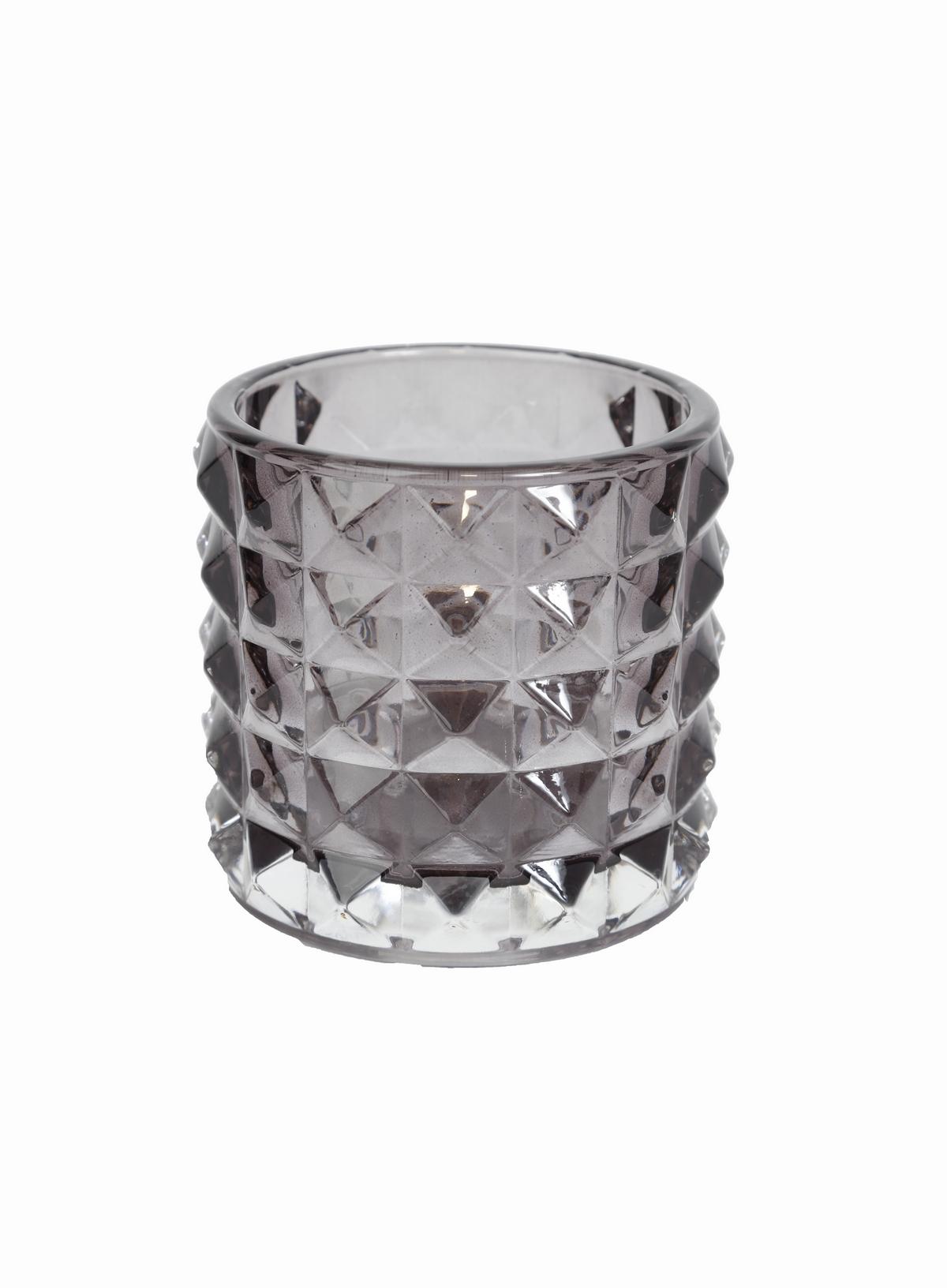 grå ljuslykta i glas