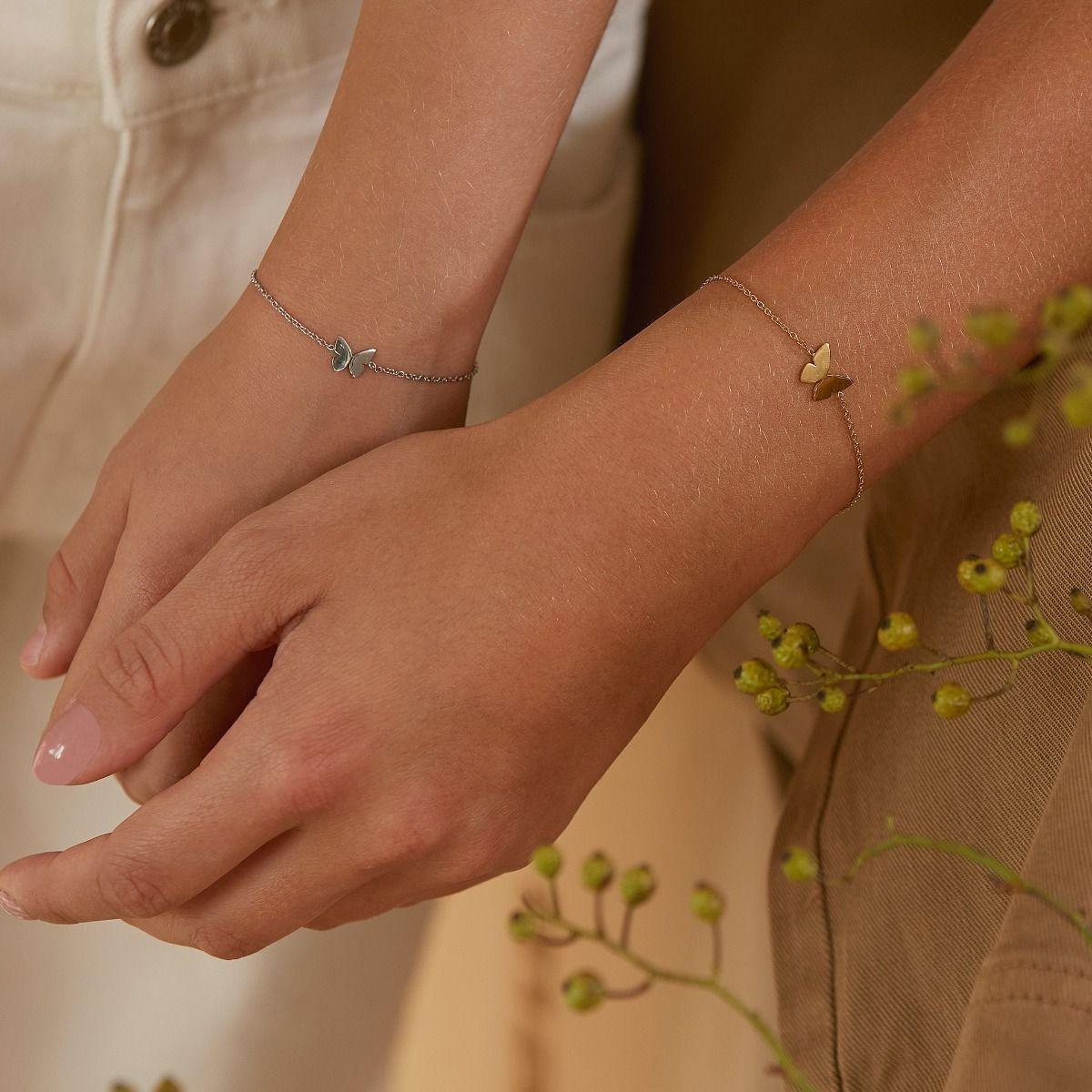 edblad-su21-papillon-bracelet-gold-bracelet-child-steel-0138-kv_1