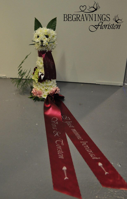 katt-av-blommor-till-begravning