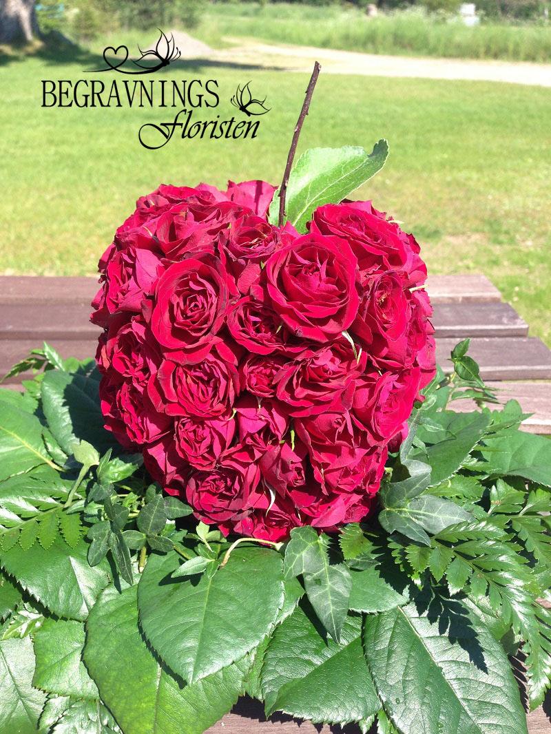blommor-begravning-rött-äpple