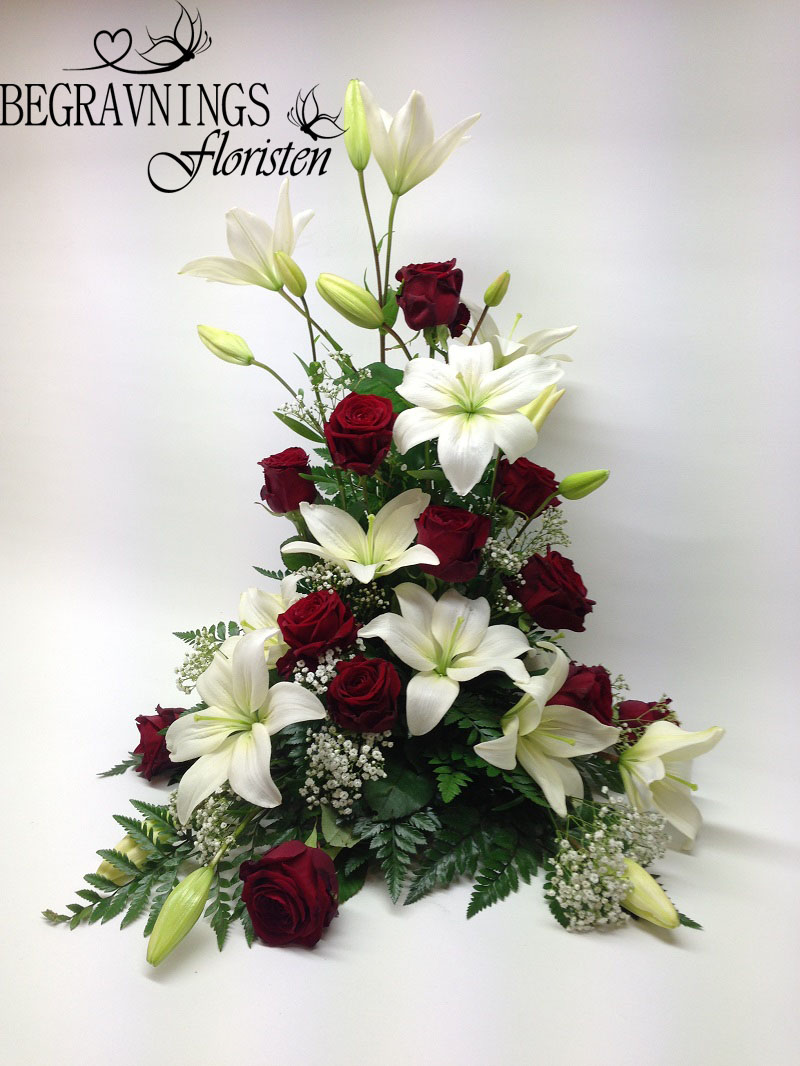 Begravningsblomma-röda-rosor-liljor