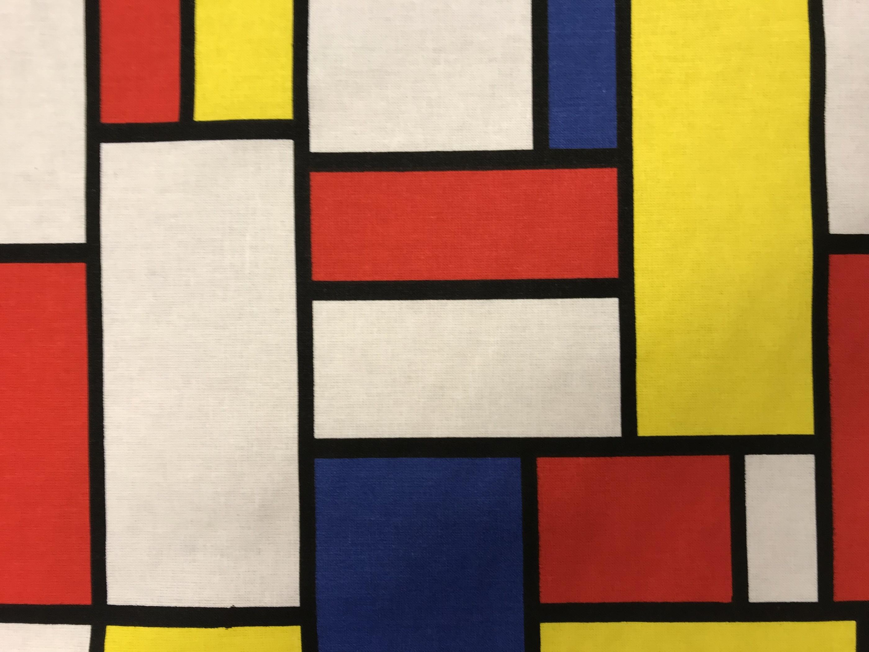 mondrian konst metervara tyg grafiskt gul blå röd vit hemtextil mode