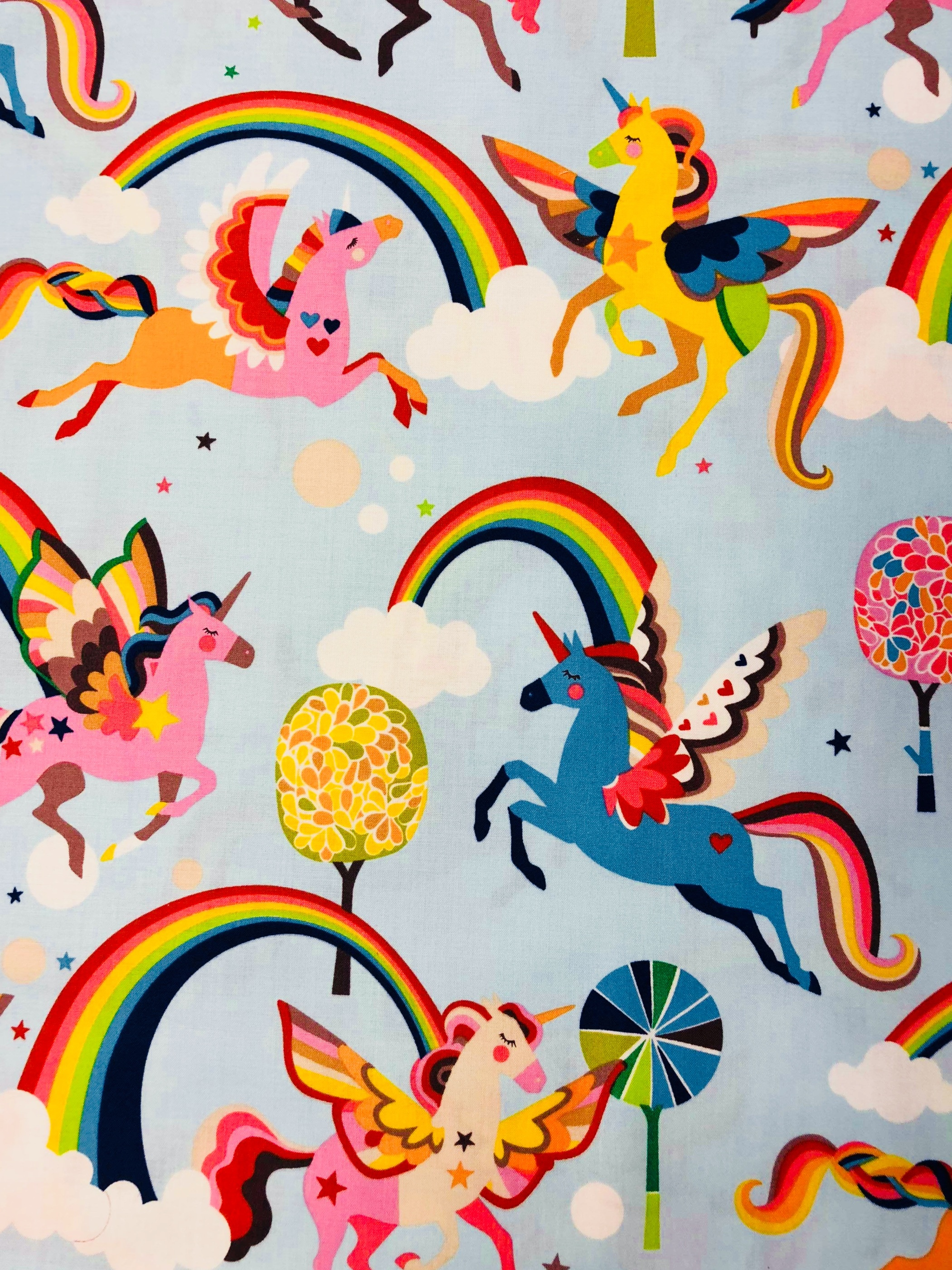 Rainbow unicorn enhörning regnbåge bomull bomullstyg metervara Tyglust Laholm barntyg