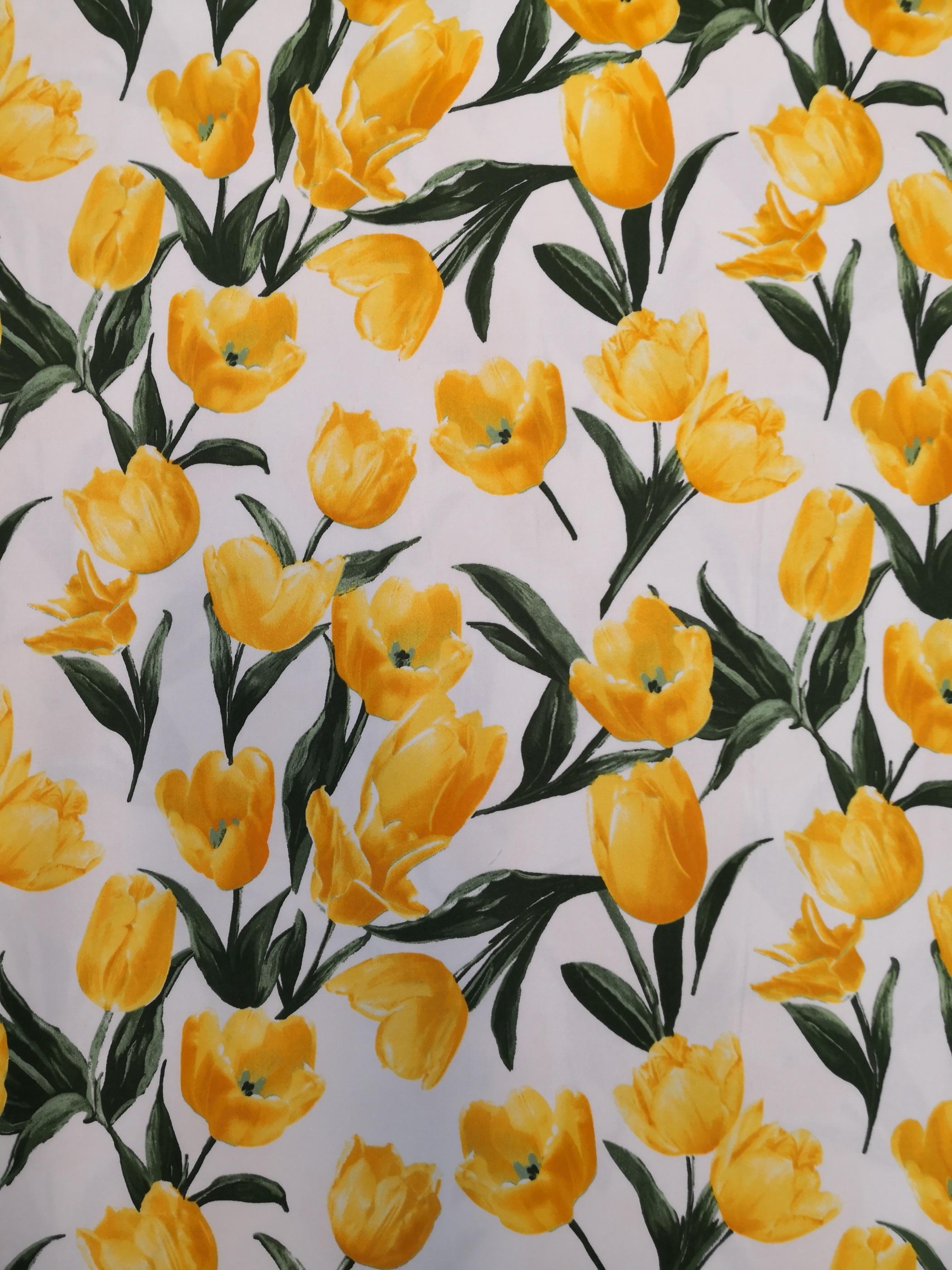 Gul tulpan blomma metervara laholm tyglust modetyg