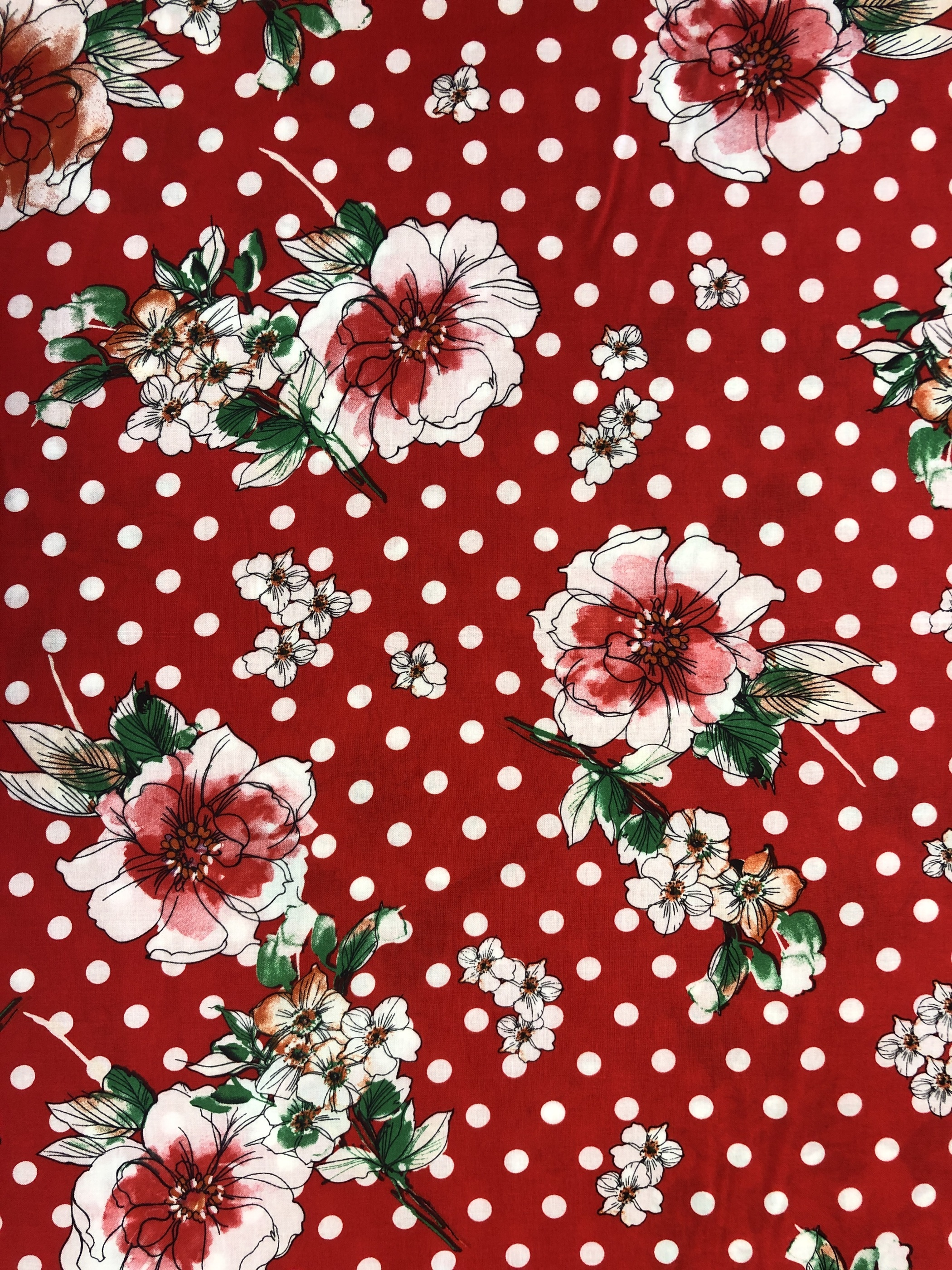 Blommigt blommor prickigt prick röd britt viskos modetyg