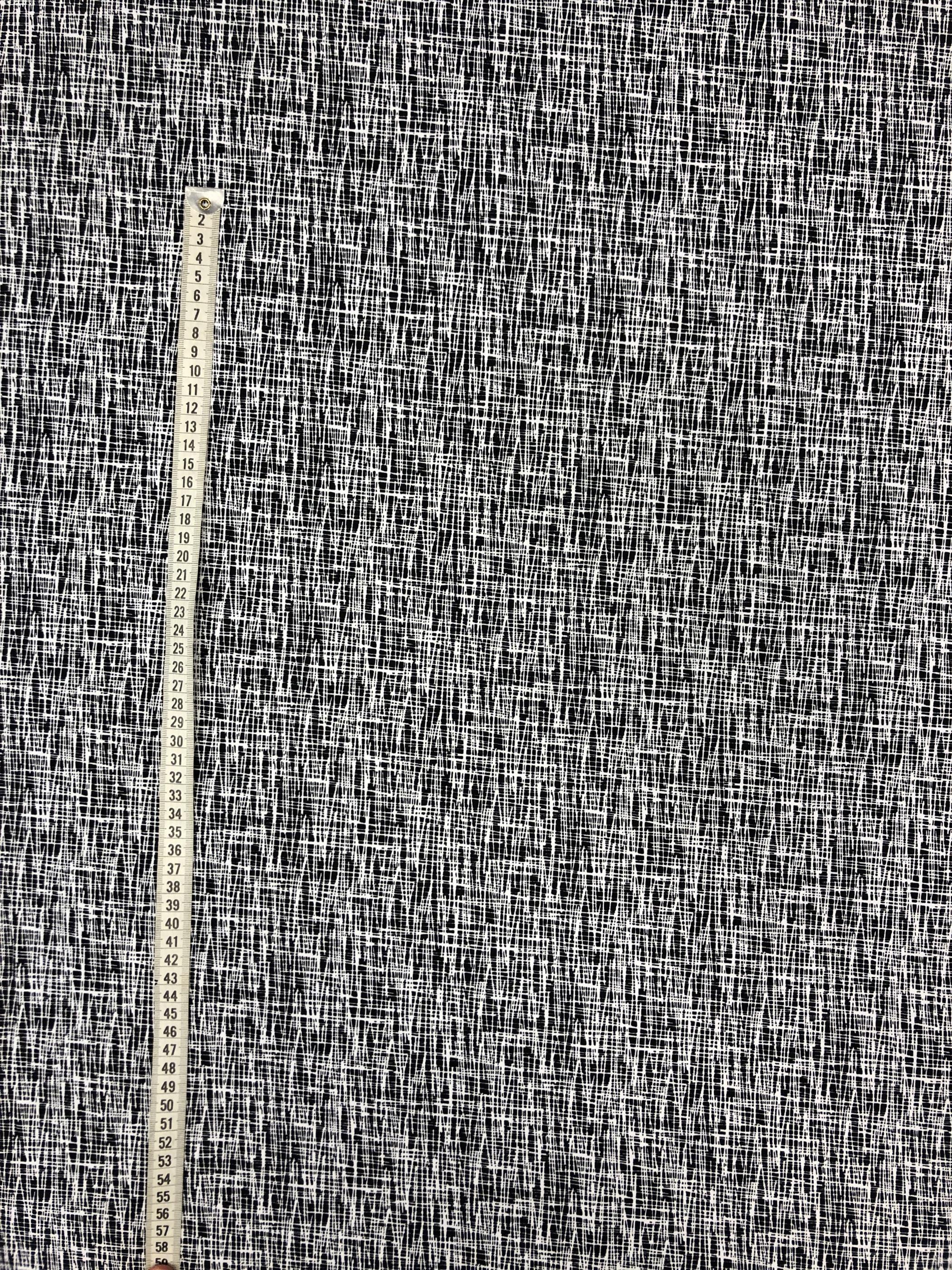 Modetyg trikå bomull skiss svart vit metervara Laholm Tyglust