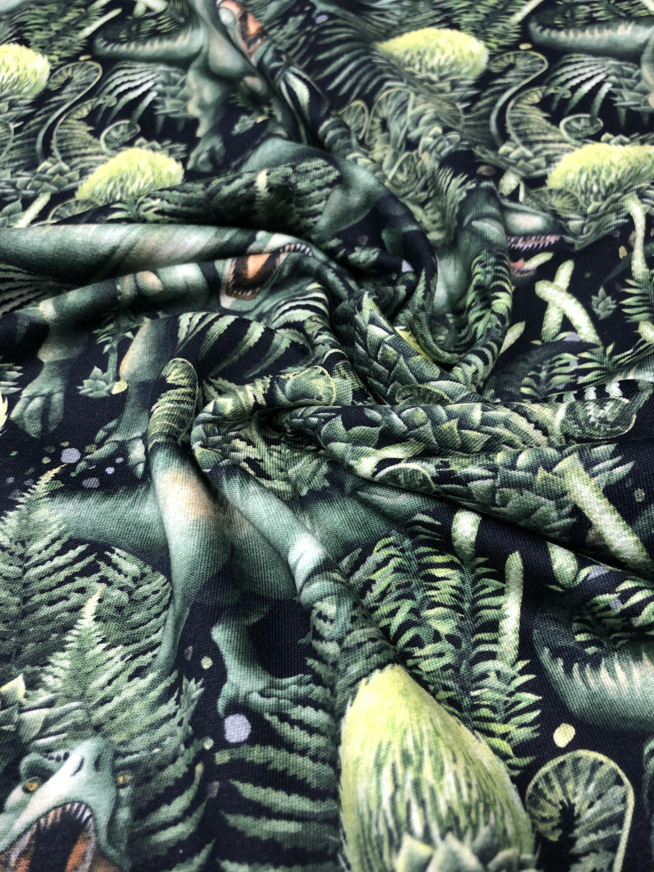 Dinosaurie metervara trikåtyg barntyg grön bomullstrikå Laholm tyglust