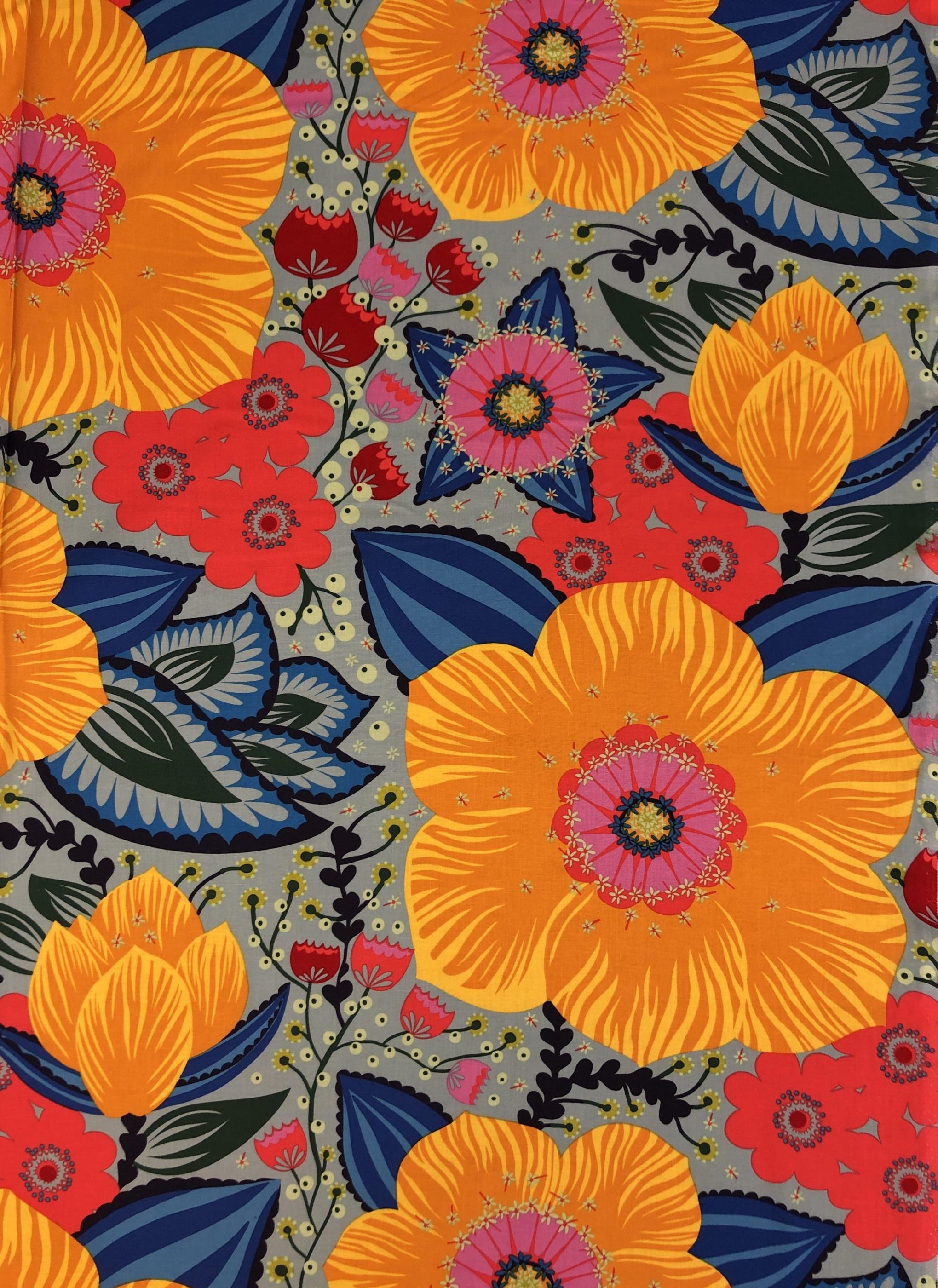 Flora blommor blommigt storblommigt grön blå rosa orange gul bomull metervara bomullsväv tyglust laholm