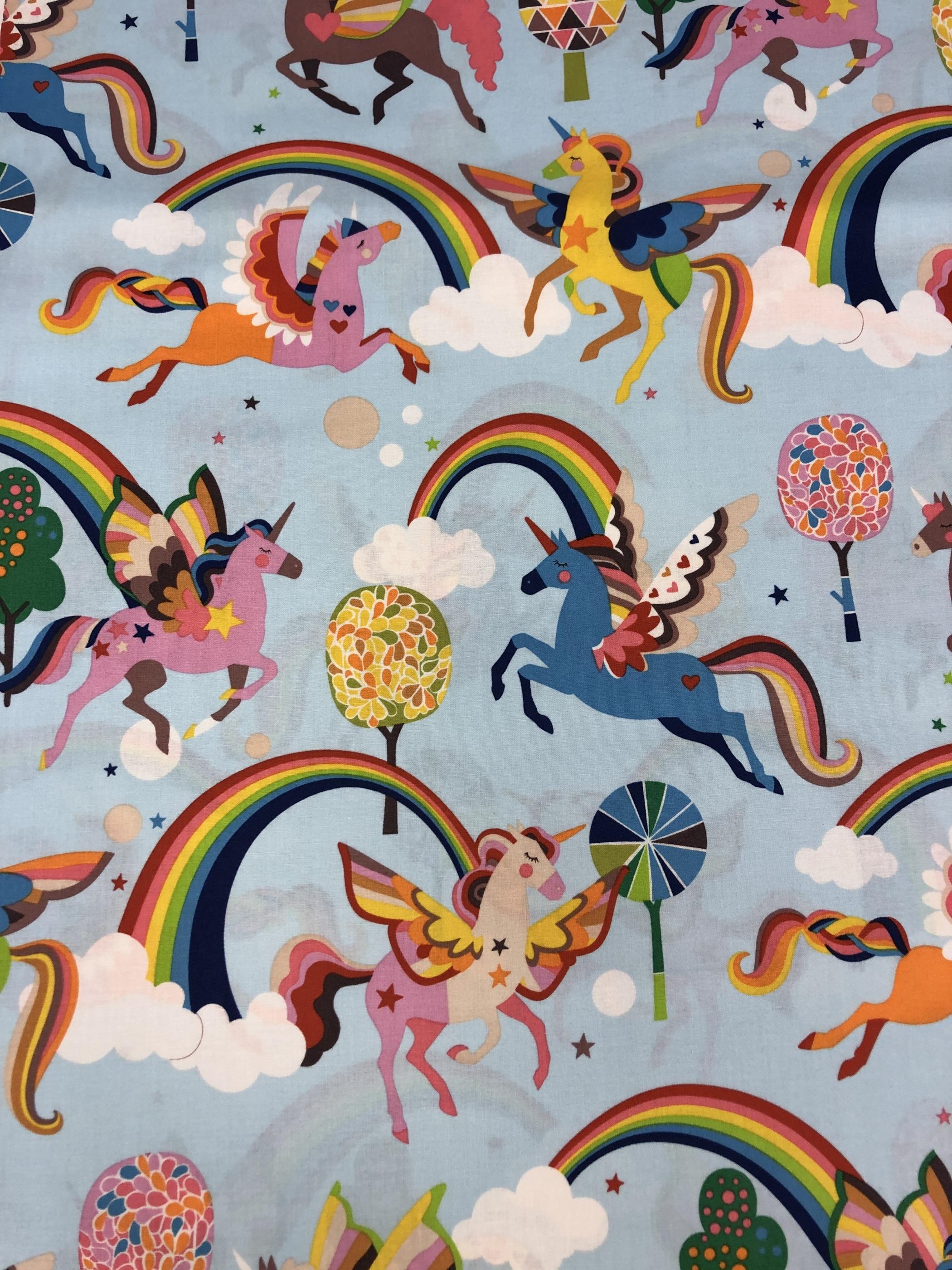drömmar enhörning regnbåde träd blå färgglad metervara bomull tyglust laholm