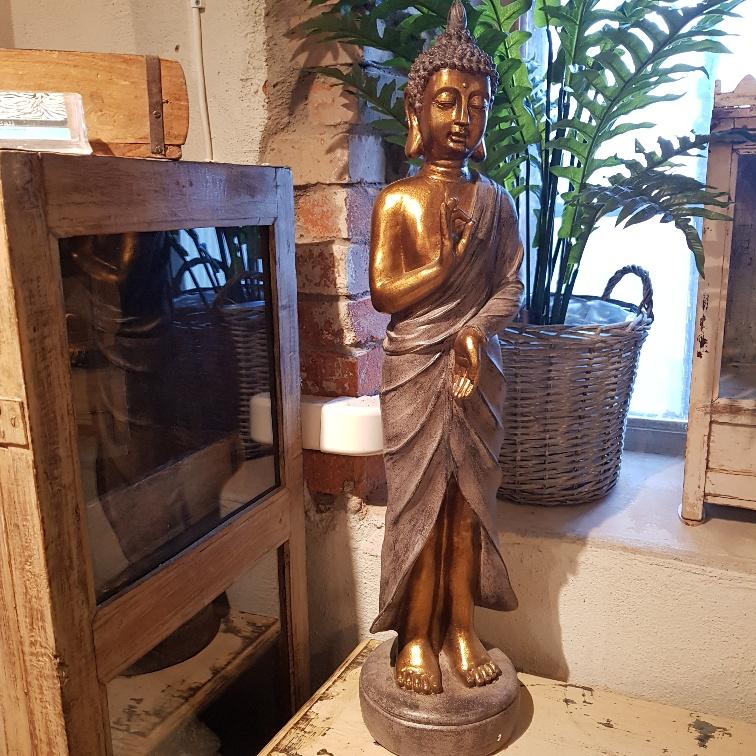 stående buddha guldig
