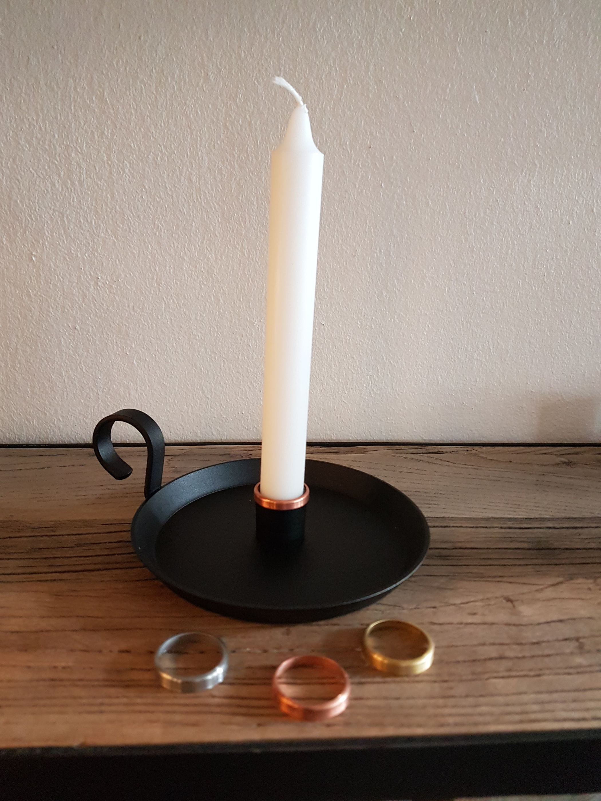 Ljusstake med dekorationsring i koppar