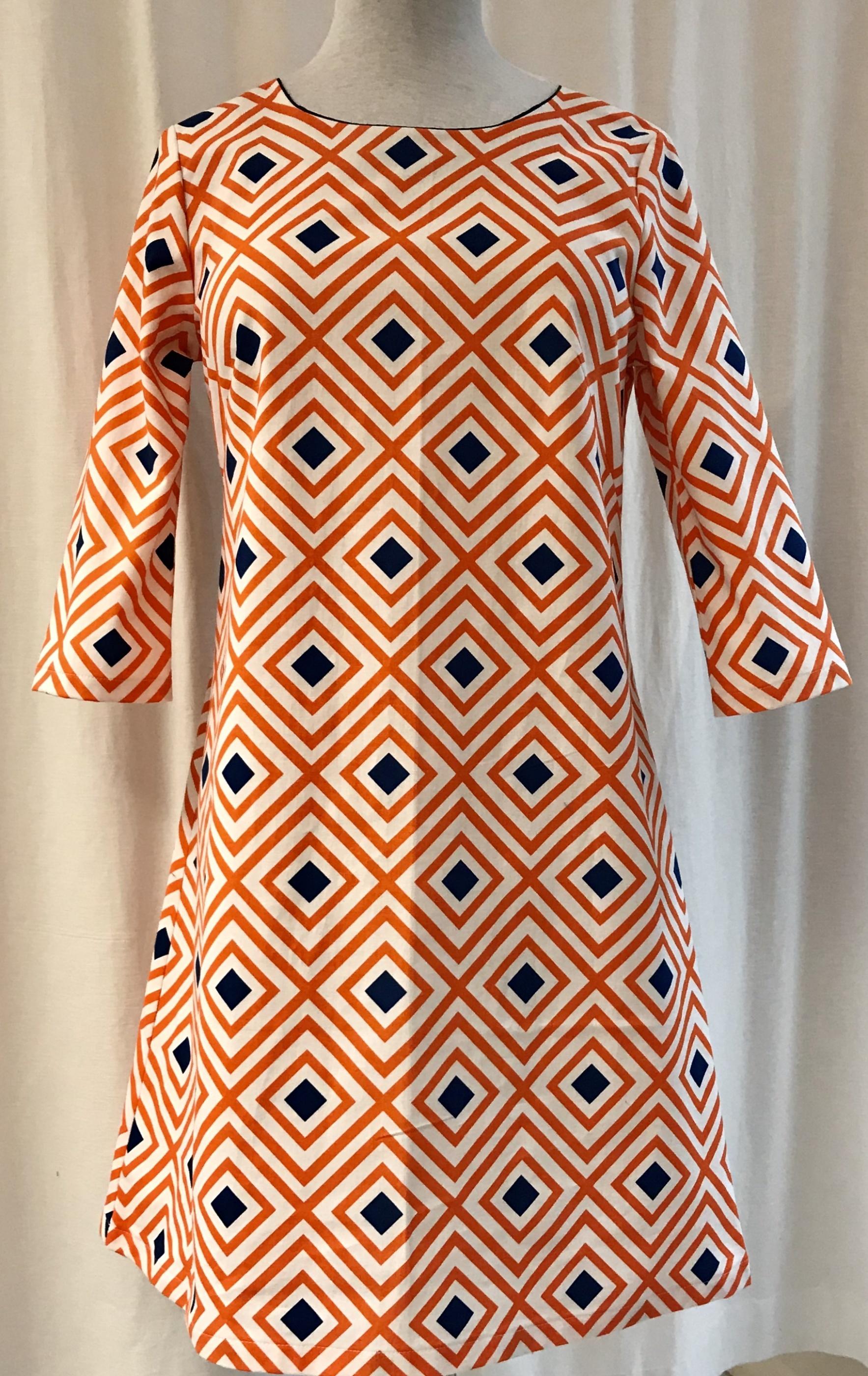 klänning solbritt SaraLaholm orange rosett gåsöga unik