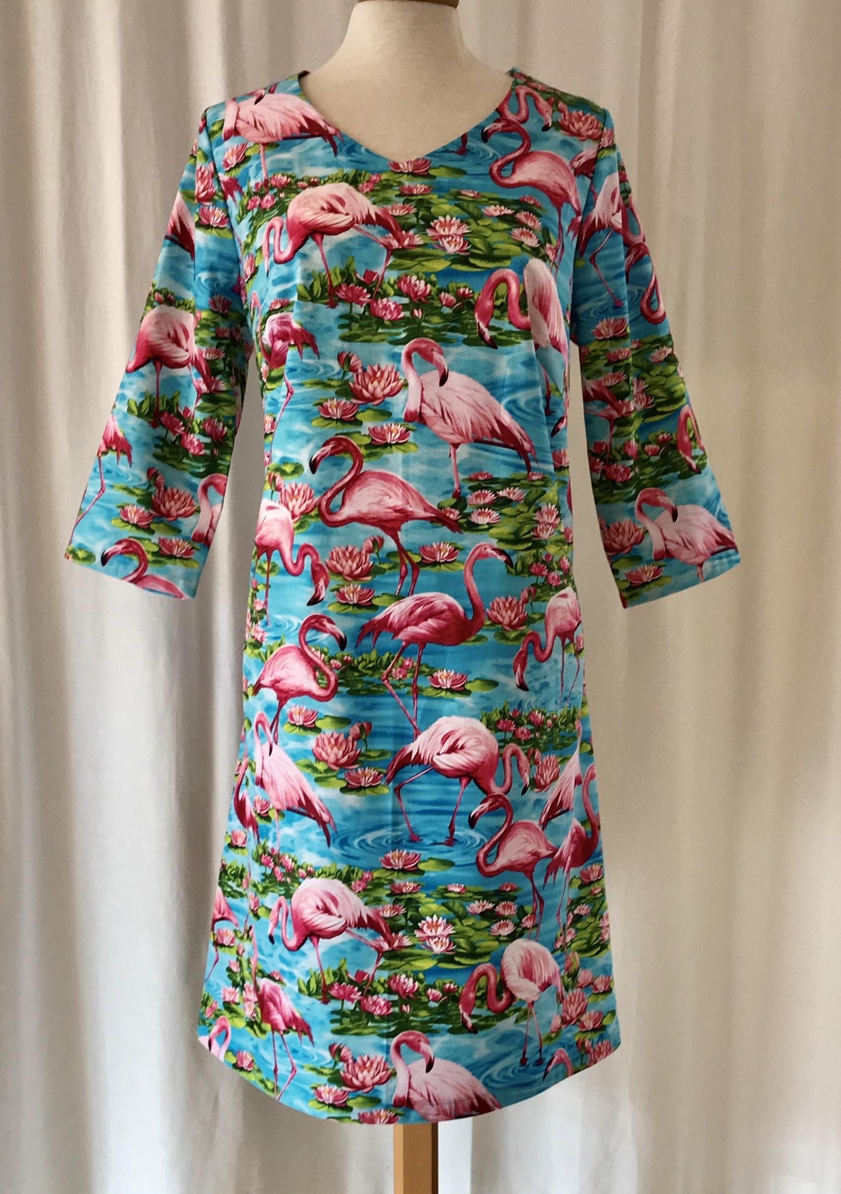 SaraLaholm klänning solbritt flamingo party turkos bomull unik design