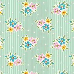 Bomullstyg blomma och prick (Tilda Nancy turkos)