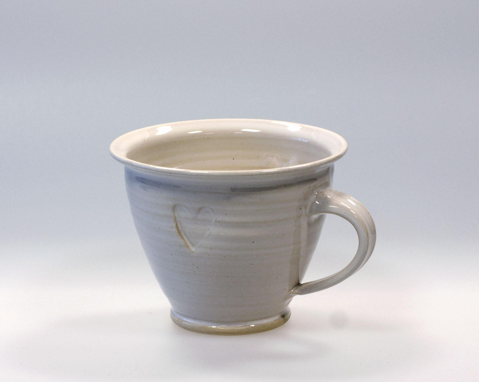 Handdrejad kopp