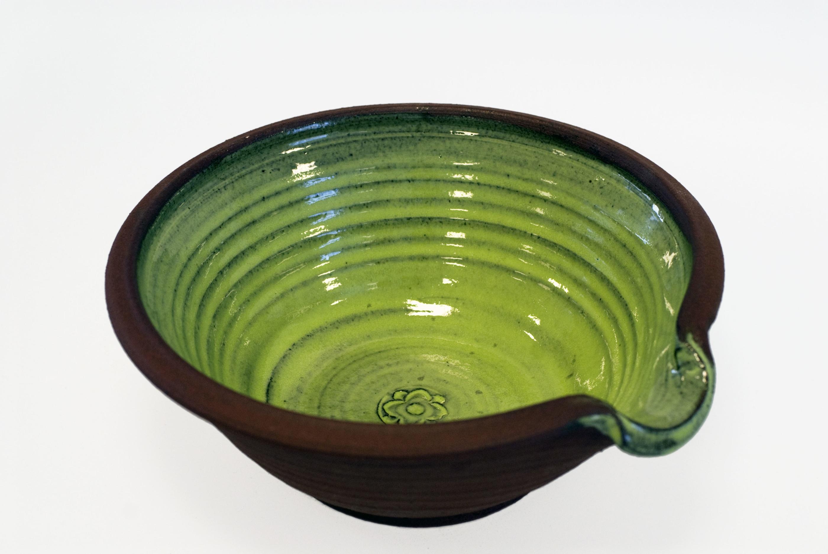 Handdrejad grön spillkum