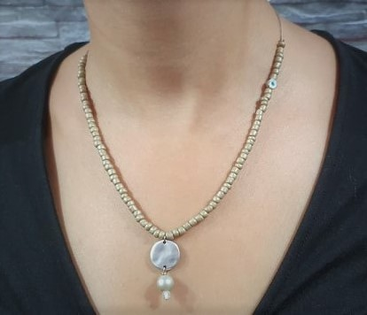 beige stone with silver, pearl and eye on the side