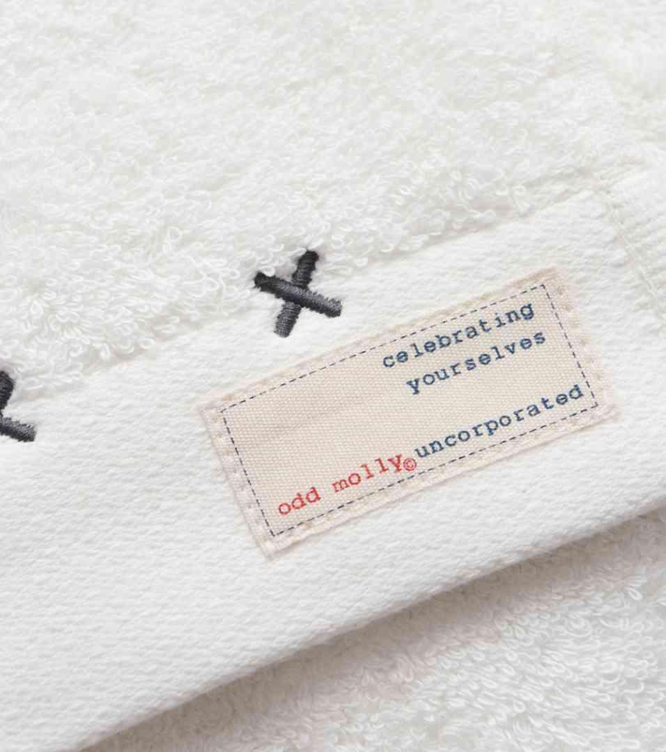 odd molly handduk, porcelain logo